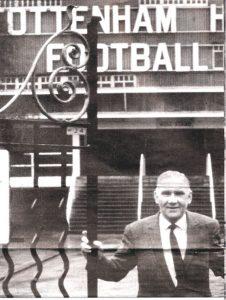 Bill Nicholson at the gates to White Hart Lane